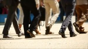Dockside_walking-group-of-people-team-spirit-close-up-of-foots-business-persons-background