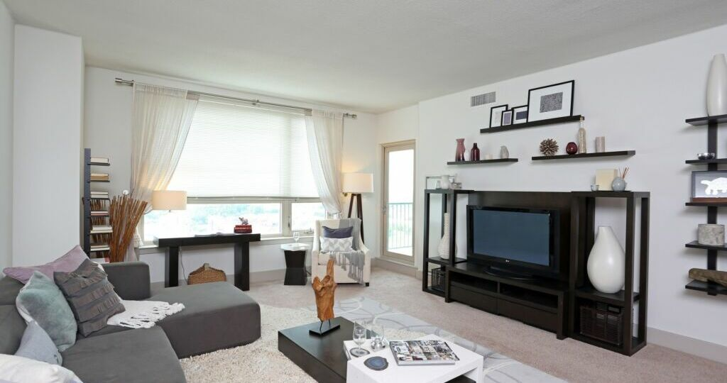 Dockside Condo Living Room Interior. Modern design with white walls and black & gray finishes.
