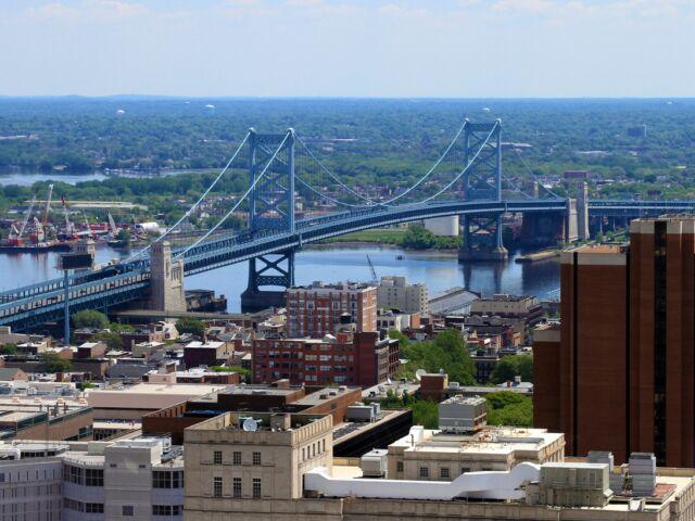 The Ben Franklin Bridge crossing over the Delaware River between Philadelphia, Pennsylvania and Camden, New Jersey.