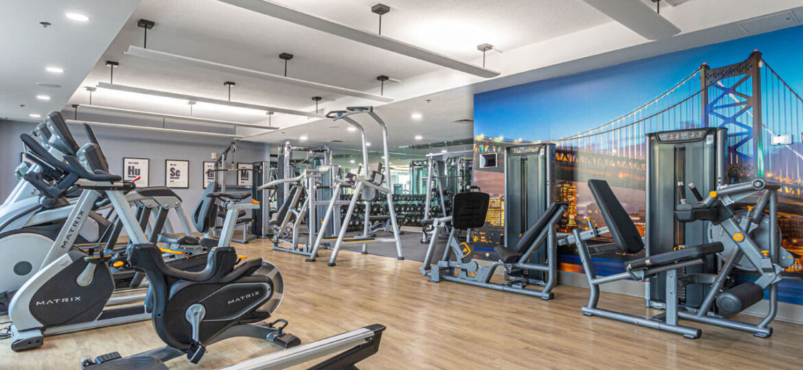 Luxury fitness center with cardio and strength training machines at Philadelphia condos for sale