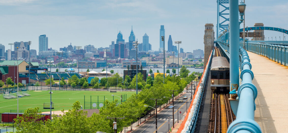Skyline of Philadelphia, Pennsylvania, USA as seen from Camden New Jersey, featuring the Delaware River and Benjamin Franklin Bridge.